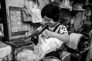 Bashful clerk working in a noodle making shop