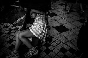 Exhausted little girl on baby buggy