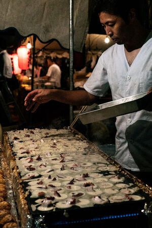 Man cooking Takoyaki