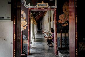 Old couple in cloister in Wat Phra Kaew