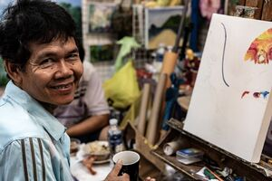 Smile of a painter in Chatuchak Market