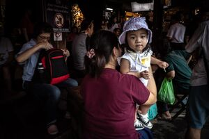 Little girl in Spanish restaurant in Chatuchak Market