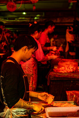 Tattoed butcher working in Khlong Toei Market