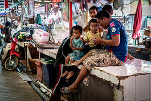 Family relaxing in Khlong Toei Market