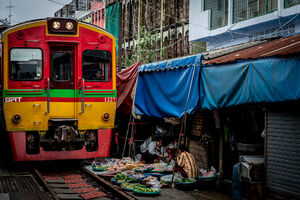 Train coming into Maeklong Railway Market