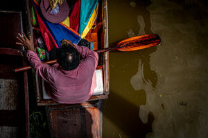 Oarsman in Damnoen Saduak Floating Market