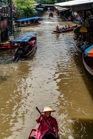 Woman paddling a rowboat