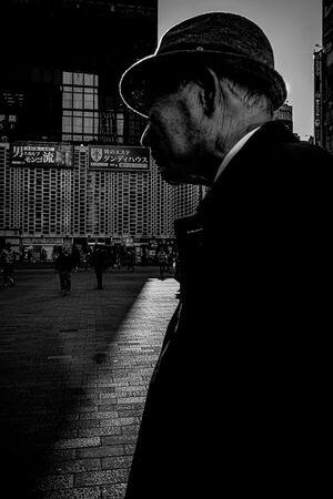 Elderly man walking the SL square