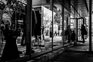 Glass-walled shop and silhouetted woman