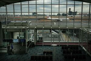 crewmen at a boarding gate in Haneda airport