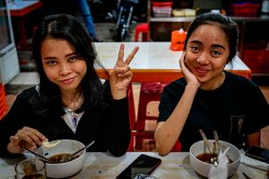 Two girls in a noodle shop