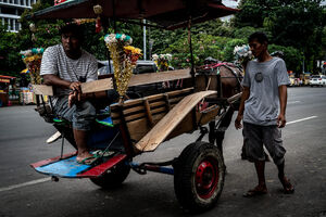 Coachmen waited for customers near Fatahillah Square in Jakarta
