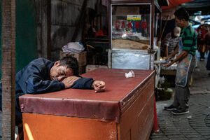 Man sleeping well in Glodok district in Jakarta