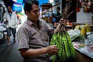 Man having large peas