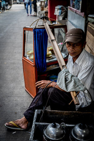 Man peddling Serabi in Glodok