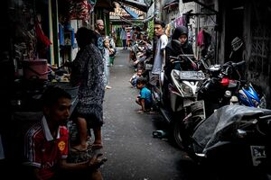 Local people hanging out in the lane in Jakarta