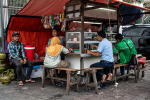 Big food stall on the side of the wide street in Jakarta