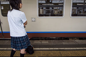 high school girl standing on platform