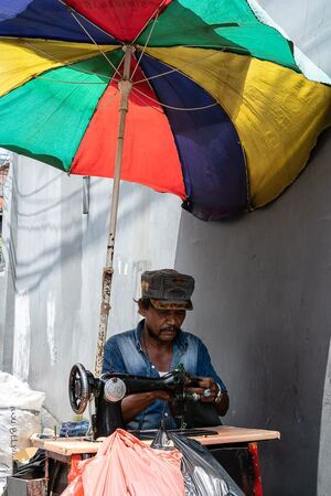 Sewing machine under a parasol parasol