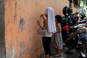 Girls scribbling on the wall