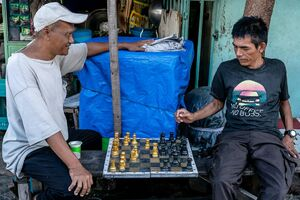 Men playing chess in the residential area