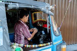 Man counting his money in Bajaj