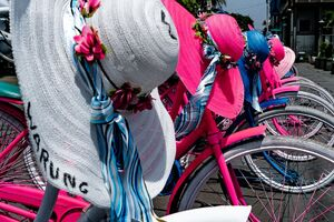 Rental bikes and colorful hats
