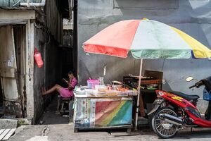 Woman relaxing behind the food stall