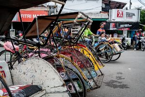 Becak parked in front of Cirebon station