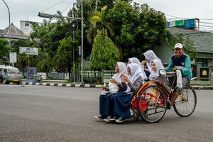 Becak with five schoolgirls