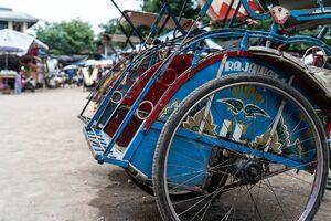 Becak parked behind the Kanoman market