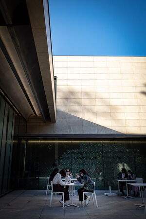 People relaxing at a table on the terrace