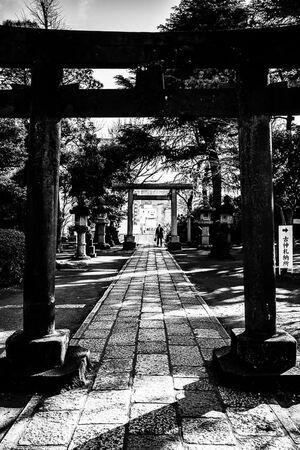 Torii gate and worshipper in Shinagawa Shrine