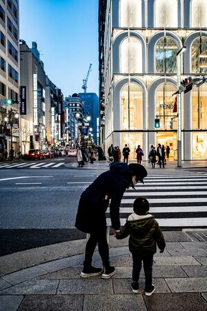 Parent and child walking through Ginza