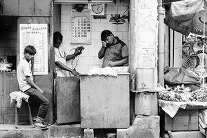 Three men in shop