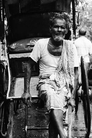 Rickshaw wallah resting