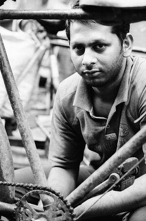Man repairing cycle ricksahw