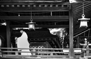 Shinto priest walking corridor
