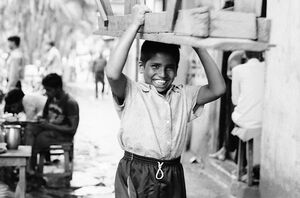Boy carrying seat