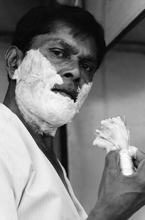 Man putting shaving cream on face
