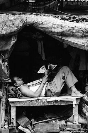 Man lying by roadside