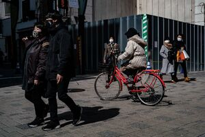 Pedestrians and a bicycle
