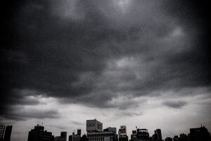 Buildings under dark clouds