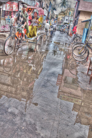 CYcle rickshaw in puddle