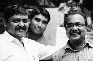 Three men smiling