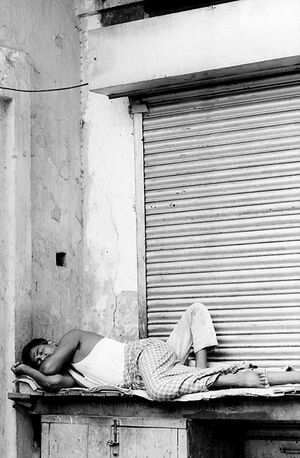 Man sleeping in front of shutter