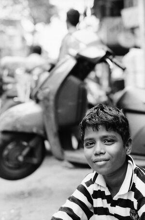Boy sitting by wayside