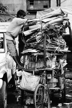 Overloaded tricycle with cardboards