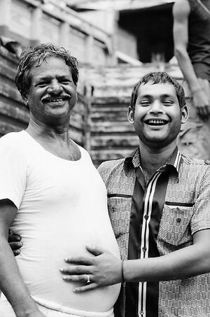 Two men laughing happily