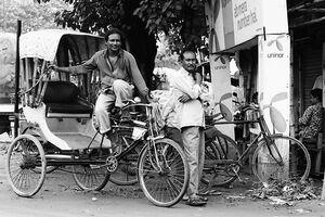 Cycle rickshaws by roadside